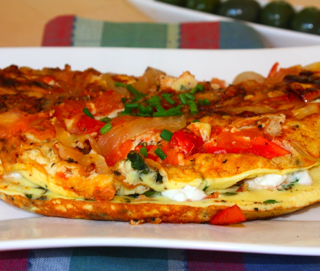 » Duck egg omelette with onions, tomatoes, goat cheese and ...